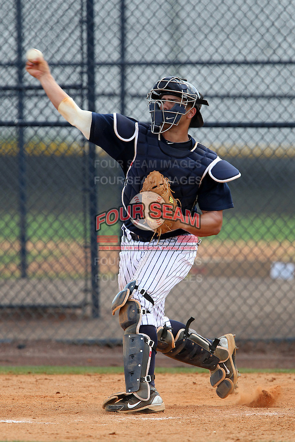 New York Yankees catcher David Remedios throws to second during a showcase featuring the Dominican Prospect League at the New York Yankees Minor League Complex on March 14, 2012 in Tampa, Florida.  (Mike Janes/Four Seam Images)