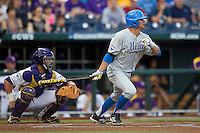 UCLA Bruin third baseman Kevin Kramer (7) follows through on his swing during Game 4 of the 2013 Men's College World Series against the LSU Tigers on June 16, 2013 at TD Ameritrade Park in Omaha, Nebraska. UCLA defeated LSU 2-1. (Andrew Woolley/Four Seam Images)