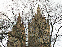 AVAILABLE FROM JEFF FOR EDITORIAL LICENSING.<br /> <br /> Defocused View of the double towers of The San Remo Apartments (a luxury co-op apartments building) on Central Park West, Viewed thru bare trees of Central Park in the Winter, Manhattan, New York City, New York State, USA.<br /> <br /> Located at 145 and 146 Central Park West (between West 74th and West 75th Streets), the San Remo was completed in 1930 by the noted architect Emery Roth.  The building has attracted many celebrity occupants thru the years such as Rita Hayworth, Donna Karan, Demi Moore, Steven Spielberg, Steve Martin, Tiger Woods, Bono, Dustin Hoffman, Eddie Cantor and the late Steve Jobs.