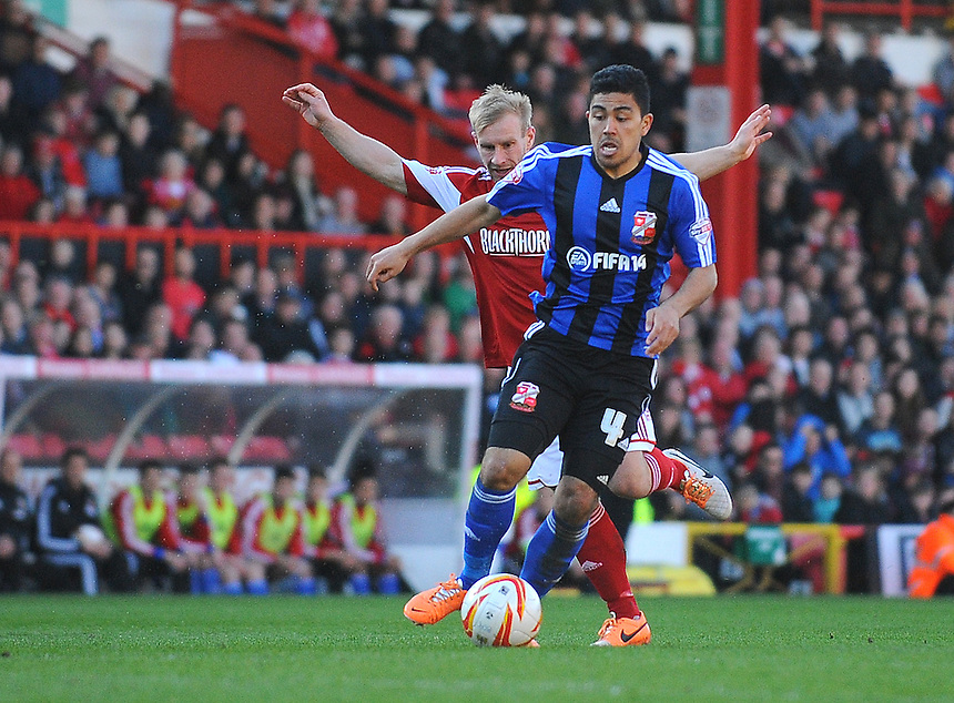 Swindon Town's Massimo Luongo under pressure from Bristol City's Simon Gillett<br /> <br /> Photo by Kevin Barnes/CameraSport<br /> <br /> Football - The Football League Sky Bet League One - Bristol City v Swindon Town - Saturday 15th March 2014 - Ashton Gate - Bristol<br /> <br /> &copy; CameraSport - 43 Linden Ave. Countesthorpe. Leicester. England. LE8 5PG - Tel: +44 (0) 116 277 4147 - admin@camerasport.com - www.camerasport.com