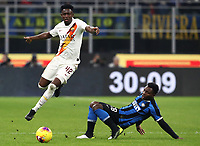 Calcio, Serie A: Inter Milano - AS Roma, Giuseppe Meazza stadium, December 6, 2019.<br /> Roma's Amadou Diawara (l) in action with Inter's Kwadwo Asamoah (l) during the Italian Serie A football match between Inter and Roma at Giuseppe Meazza (San Siro) stadium, on December 6, 2019.<br /> UPDATE IMAGES PRESS/Isabella Bonotto