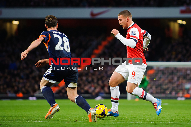 Arsenal Forward Lukas Podolski (GER) is challenged by Fulham Midfielder Scott Parker (ENG) during the match -  - 18/01/14 - SPORT - FOOTBALL - Emirates Stadium - Arsenal v Fulham - Barclays Premier League.<br /> Foto nph / Meredith<br /> <br /> ***** OUT OF UK *****