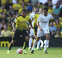 Troy Deeney of Watford and Jack Cork of Swansea   during the Barclays Premier League match Watford and Swansea   played at Vicarage Road Stadium , Watford