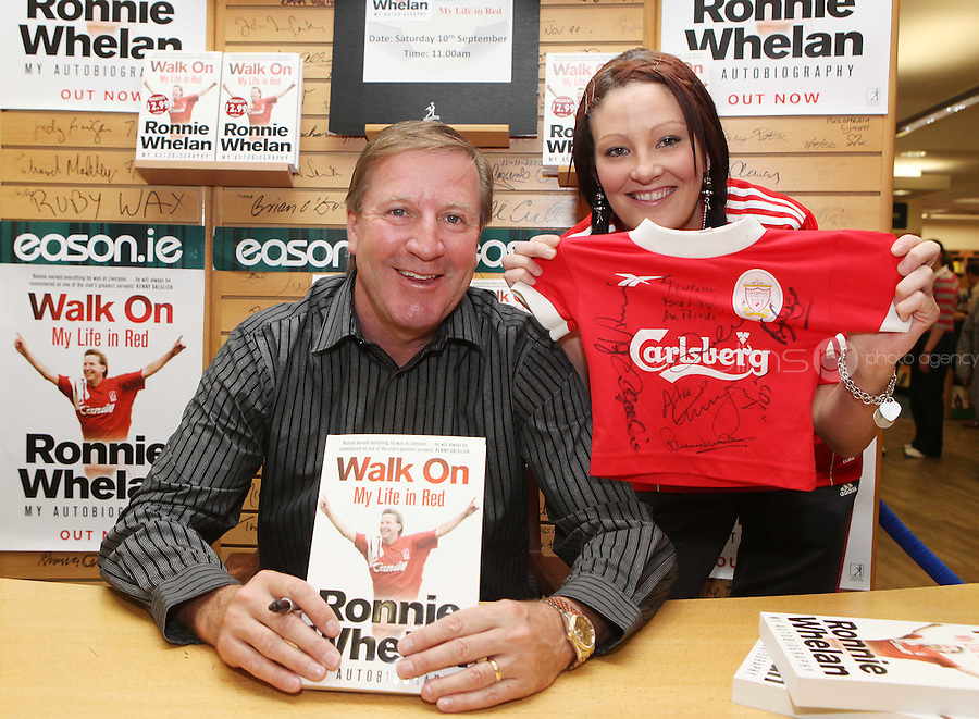 ***NO FEE PIC ***.10/09/2011.Eason Ireland's leading retailer of books , stationery, magazines & lots more hosted a book signing by former Liverpool & Irish international soccer player Ronnie Whelan..Pictured at Eason O' Connell street, Dublin is Ronnie Whelan &  Mairead murphy from Templeogue signing copies of his new autobiography WALK ON for fans..Follow Eason on twitter- @easons..Photo: Collins
