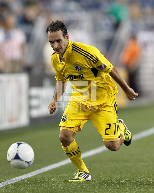 Columbus Crew defender Sebastian Miranda (21) dribbles down the wing. In a Major League Soccer (MLS) match, the New England Revolution defeated Columbus Crew, 2-0, at Gillette Stadium on September 5, 2012.