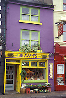 AJ0952, Europe, Republic of Ireland, Ireland, A colorful purple and yellow store front display flowers at Brawn's Florist in Westport in County Mayo.