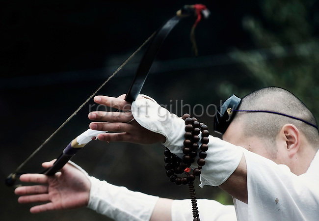 A priest of the Shingon sect offers a bow which will be used to shoot a sacred arrow into a bonfire for blessing during the hiwatari fire-walking ceremony in Takao, west of Tokyo, Japan on Sunday 09 March  2009.
