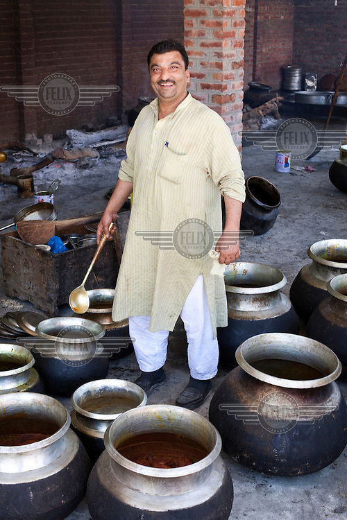 A portrait of Khan Mohammed Sharief Waza, a traditional Kashmiri chef at a Wazwan feast. Wazwan is a traditional Kashmiri feast, largely consisting of meat dishes, which is served on special occasions. /Felix Features