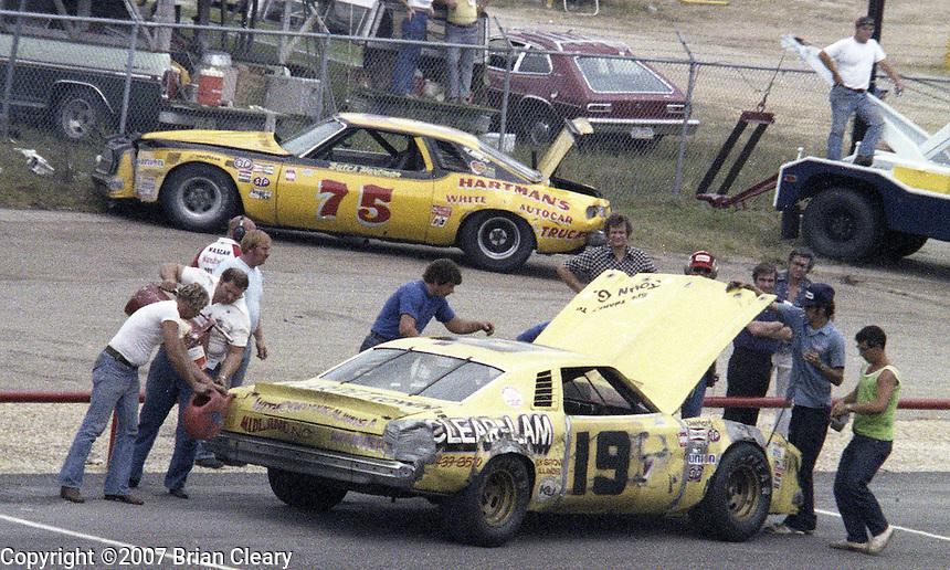 Bobby Wawak #19 Chevrolet hood up pits pit stop 22nd place finish #75 Butch Hartman chevrolet garage background Southern 500 Darlington Raceway, Darlington SC, September 5, 1977.(Photo by Brian Cleary/www.bcpix.com)