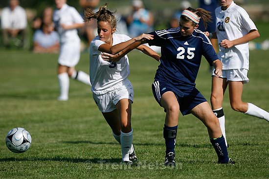 South Jordan - Bingham's Liz Christensen (center) tries to control the ball with Juan Diego's Jenn Flynn (left) and Shannon Kelliher defending. Bingham vs. Juan Diego girls high school soccer Tuesday, August 25 2009. 3A Juan Diego managed to tie 5A Bingham 3-3..