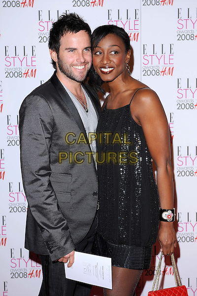 GUEST & BEVERLEY KNIGHT.Attending the ELLE Style Awards 2008,.The Westway, London, England,.February 12th 2008..half length black dress Beverly.CAP/BEL.©Tom Belcher /Capital Pictures