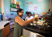 NWA Democrat-Gazette/JASON IVESTER<br /> Chelsea Hildalgo, 17, makes taiyaki for customers Thursday, May 25, 2017, during an open house for Anime Cafe in downtown Rogers.