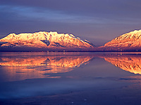 The winter sun at dusk paints warm colors on Mount Timpanogos in central Utah