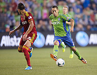 Clint Dempsey, right, of the Seattle Sounders FC dribbles the ball against Carlos Salcedo of Real Salt Lake at CenturyLink Field in Seattle Friday September 13, 2013. The Sounders won the match 2-0.