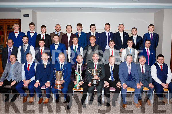 The Ballyduff senior hurlers  with their invited guests, displaying the silverware they won at their social in the Rose Hotel on Saturday night last.