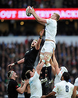 George Kruis of England steals the lineout ball ahead of Kieran Read of New Zealand during the QBE International match between England and New Zealand at Twickenham Stadium on Saturday 8th November 2014 (Photo by Rob Munro)