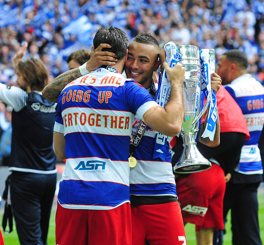 Queens Park Rangers' Charlie Austin, left, celebrates promotion to the Premier League with team-mate Danny Simpson<br /> <br /> Photographer Chris Vaughan/CameraSport<br /> <br /> Football - The Football League Sky Bet Championship Play-Off Final - Derby County v Queens Park Rangers - Saturday 24th May 2014 - Wembley Stadium - London<br /> <br /> &copy; CameraSport - 43 Linden Ave. Countesthorpe. Leicester. England. LE8 5PG - Tel: +44 (0) 116 277 4147 - admin@camerasport.com - www.camerasport.com