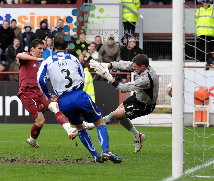 Bruno Aguiar scores the third goal and celebrates by sticking the ball up his jersey during the Hearts v Kilmarnock SPL match at Tynecastle Stadium