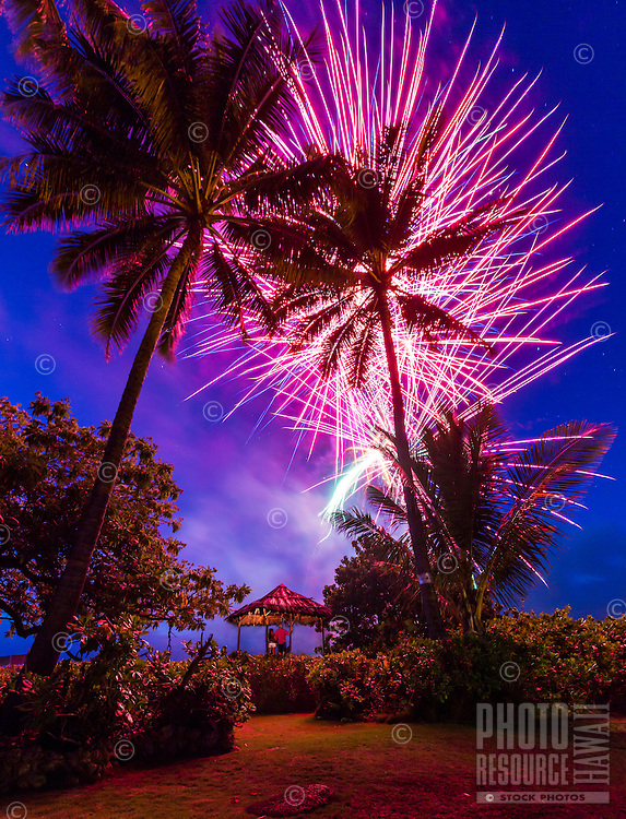 A couple enjoys the fireworks on the beach on Independence Day, Waialua Beach, O'ahu.