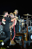 WEST PALM BEACH, FL - AUGUST 05: Singer Jeremy McKinnon, Musician Joshua Woodward and Alex Shelnutt of A Day To Remember perform at Perfect Vodka Amphitheatre on August 5, 2016 in West Palm Beach, Florida. Credit: MPI10 / MediaPunch