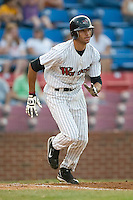 Winston-Salem center fielder Paulo Orlando (18) watches the flight of the ball as he starts down the first base line versus Wilmington at Ernie Shore Field in Winston-Salem, NC, Saturday, June 9, 2007.