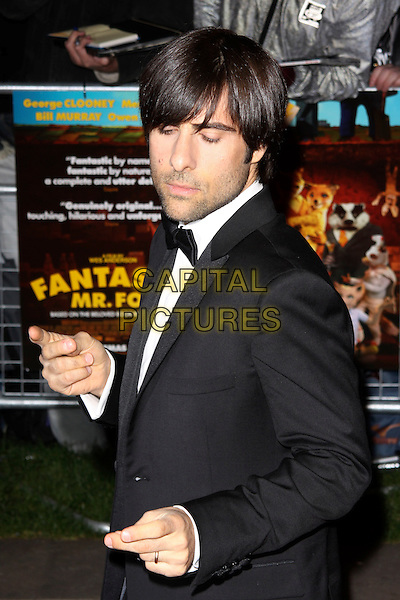 JASON SCHWARTZMAN  .Premiere of 'Fantastic Mr. Fox' on the opening Gala for The Times BFI London Film Festival at the Odeon Leicester Square, London, England..October 14th, 2009.half length black tuxedo hands eyes closed funny face fingers gesture stubble facial hair .CAP/AH.©Adam Houghton/Capital Pictures.
