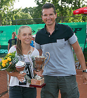 August 9, 2014, Netherlands, Rotterdam, TV Victoria, Tennis, National Junior Championships, NJK,  Prize giving, Richard Krajicek with Perla Nieuwboer, winner girls 14 years<br /> Photo: Tennisimages/Henk Koster