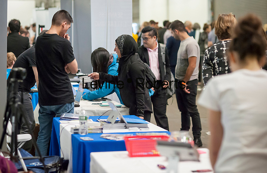 Visitors and job seekers crowd the TechDay New York event on Tuesday, April 18, 2017. Thousands attended to seek jobs with the startups and to network with their peers. TechDay bills itself as the U.S.'s largest startup event with over 500 exhibitors. (© Richard B. Levine)