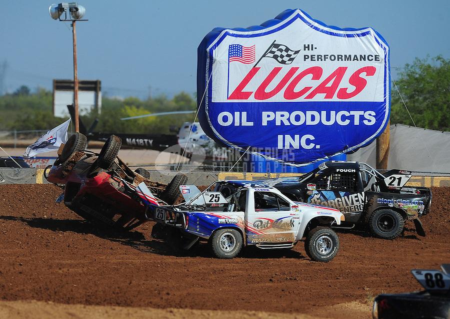 Apr 16, 2011; Surprise, AZ USA; LOORRS driver Wyatt Kirchner (26) flips over alongside Patrick Clark (25) during round 3 at Speedworld Off Road Park. Mandatory Credit: Mark J. Rebilas-.