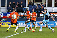 Paul Hayes of Wycombe Wanderers (right) sees his shot blocked during the Sky Bet League 2 match between Luton Town and Wycombe Wanderers at Kenilworth Road, Luton, England on 26 December 2015. Photo by David Horn.