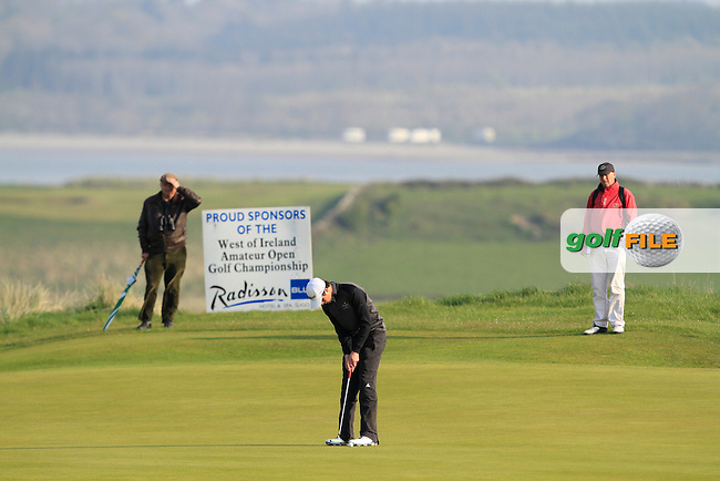 Gary Hurley (West Waterford) on the 4th green during the Semi-Finals of The West of Ireland Amateur Open in Co. Sligo Golf Club on Tuesday 22nd April 2014.<br /> Picture:  Thos Caffrey / www.golffile.ie