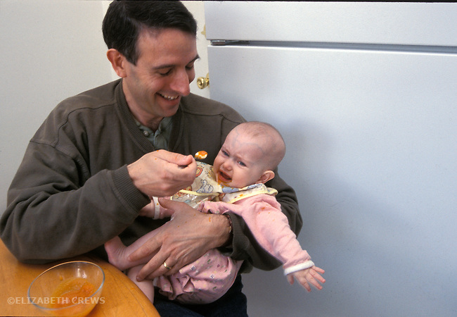 Berkeley CA Father trying to feed reluctant baby solid food--carrots.  Infant five-months-old    MR