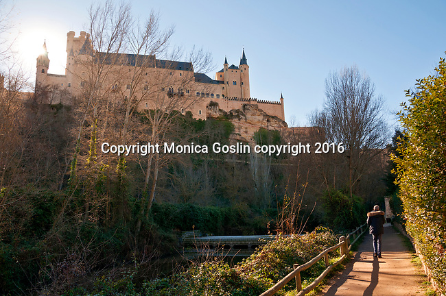 Alcazar, the picturesque castle in Segovia, Spain as seen from a path along the river below the castle
