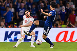 Alireza Jahan Bakhsh Jirandeh of Iran (L) fights for the ball with Tsukasa Shiotani of Japan (R) during the AFC Asian Cup UAE 2019 Semi Finals match between I.R. Iran (IRN) and Japan (JPN) at Hazza Bin Zayed Stadium  on 28 January 2019 in Al Alin, United Arab Emirates. Photo by Marcio Rodrigo Machado / Power Sport Images
