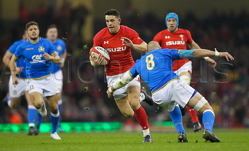 11th March 2018, Principality Stadium, Cardiff, Wales; NatWest Six Nations rugby, Wales versus Italy; Owen Watkin of Wales evades the attempted tackle from Sergio Parisse of Italy