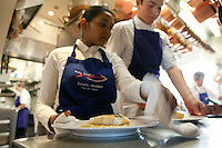 A waitress collects a dish from the kitchen at Jacques Maximin's restaurant Le Bistro de la Marine, Cagnes sur Mer, France, 07 April 2012