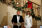 United States President Donald J. Trump makes remarks as First lady Melania Trump looks on at the Congressional Ball at White House in Washington, DC on December 15, 2018. <br /> Credit: Yuri Gripas / Pool via CNP