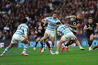 Jonathan Joseph of England is tackled by Ramiro Moyano of Argentina during the Old Mutual Wealth Series match between England and Argentina at Twickenham Stadium on Saturday 11th November 2017 (Photo by Rob Munro/Stewart Communications)