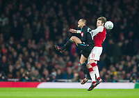 West Ham's Chicharito and Arsenal's Calum Chambers during the Carabao Cup QF match between Arsenal and West Ham United at the Emirates Stadium, London, England on 19 December 2017. Photo by Andrew Aleksiejczuk / PRiME Media Images.