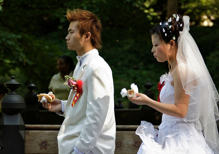 Unusual wedding scene, Central Park, New York. Perhaps the food was not good at the reception?