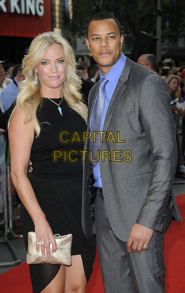 guest & Michael Wildman.'The Sweeney' European film premiere, Vue West End cinema, Leicester Square, London, England..September 3rd, 2012.half length suit black dress clutch bag gold blue shirt grey gray tie.CAP/CAN.©Can Nguyen/Capital Pictures.