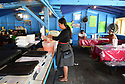 Delicia Jendi serves El Salvadoran food at the Algiers Flea Market. Jendi Bonilla cooks at her restaurant.