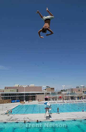Leaping off the ten meter platform at the Kearns Oquirrh Park Fitness Center in Kearns Wednesday afternoon.<br />