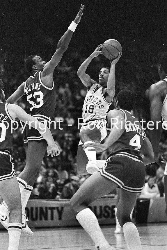 Warriors Lorenzo Romar drives against the Utah Jazz Darryl Dawkins. (1981 photo/Ron Riesterer)