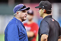 Princeton Rays manager Rafael Valenzuela argues a call with first base umpire Clay Williams during game two of the Appalachian League Championship Series against the Elizabethton Twins at Joe O'Brien Field on September 5, 2018 in Elizabethton, Tennessee. The Twins defeated the Rays 2-1 to win the Appalachian League Championship. (Tony Farlow/Four Seam Images)
