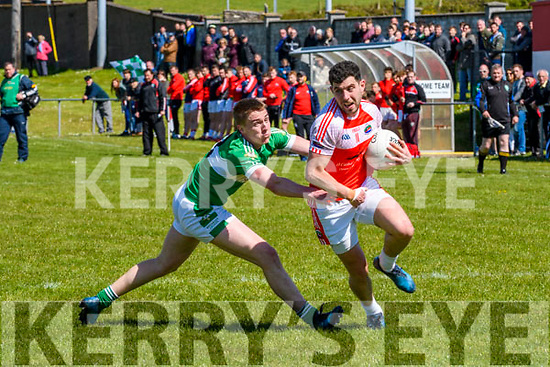 Daingean Uí Chúis Mikey Geaney tackled by Legion Danny Sheahan during the Club Football Senior Championship at Pairc Aghasaigh, Dingle, on Sunday afternoon.