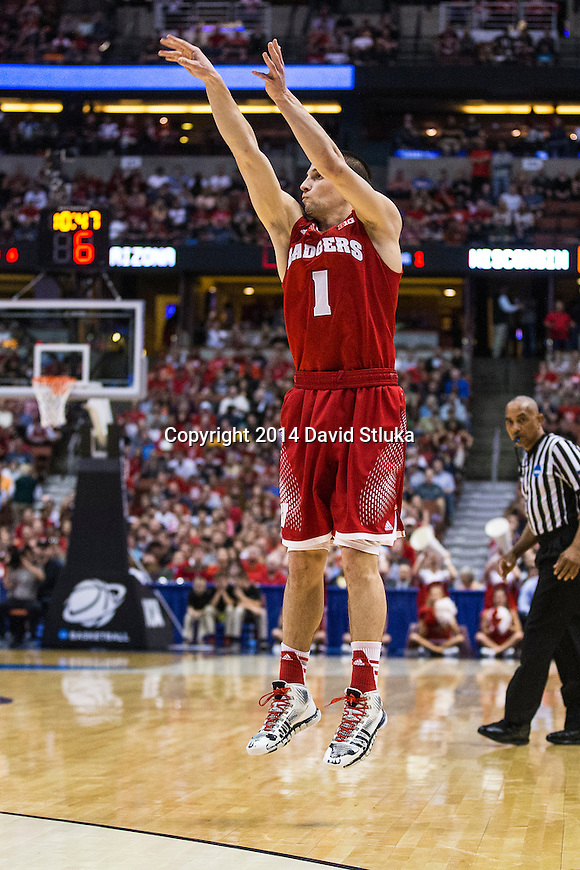 Wisconsin Badgers guard Ben Brust (1) shoots a 3-pointer during the Western Regional Final NCAA college basketball tournament game against the Arizona Wildcats Saturday, March 29, 2014 in Anaheim, California. The Badgers won 64-63 (OT). (Photo by David Stluka)
