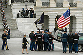 The flag-draped casket of former President George H.W. Bush is transported from the U.S. Capitol to the National Cathedral Wednesday, Dec. 5, 2018, in Washington. (Sarah Silbiger/The New York Times via AP, Pool)<br /> Credit: Sarah Silbiger / Pool via CNP