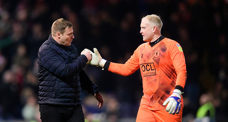 Mansfield Town manager David Flitcroft, left, and Mansfield Town's Conrad Logan at the end of the game<br /> <br /> Photographer Chris Vaughan/CameraSport<br /> <br /> The EFL Sky Bet League Two - Mansfield Town v Lincoln City - Monday 18th March 2019 - Field Mill - Mansfield<br /> <br /> World Copyright © 2019 CameraSport. All rights reserved. 43 Linden Ave. Countesthorpe. Leicester. England. LE8 5PG - Tel: +44 (0) 116 277 4147 - admin@camerasport.com - www.camerasport.com