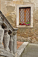 Medieval stone railing and window, Monteriggioni, in the Province of Siena, in the Tuscany region, Italy